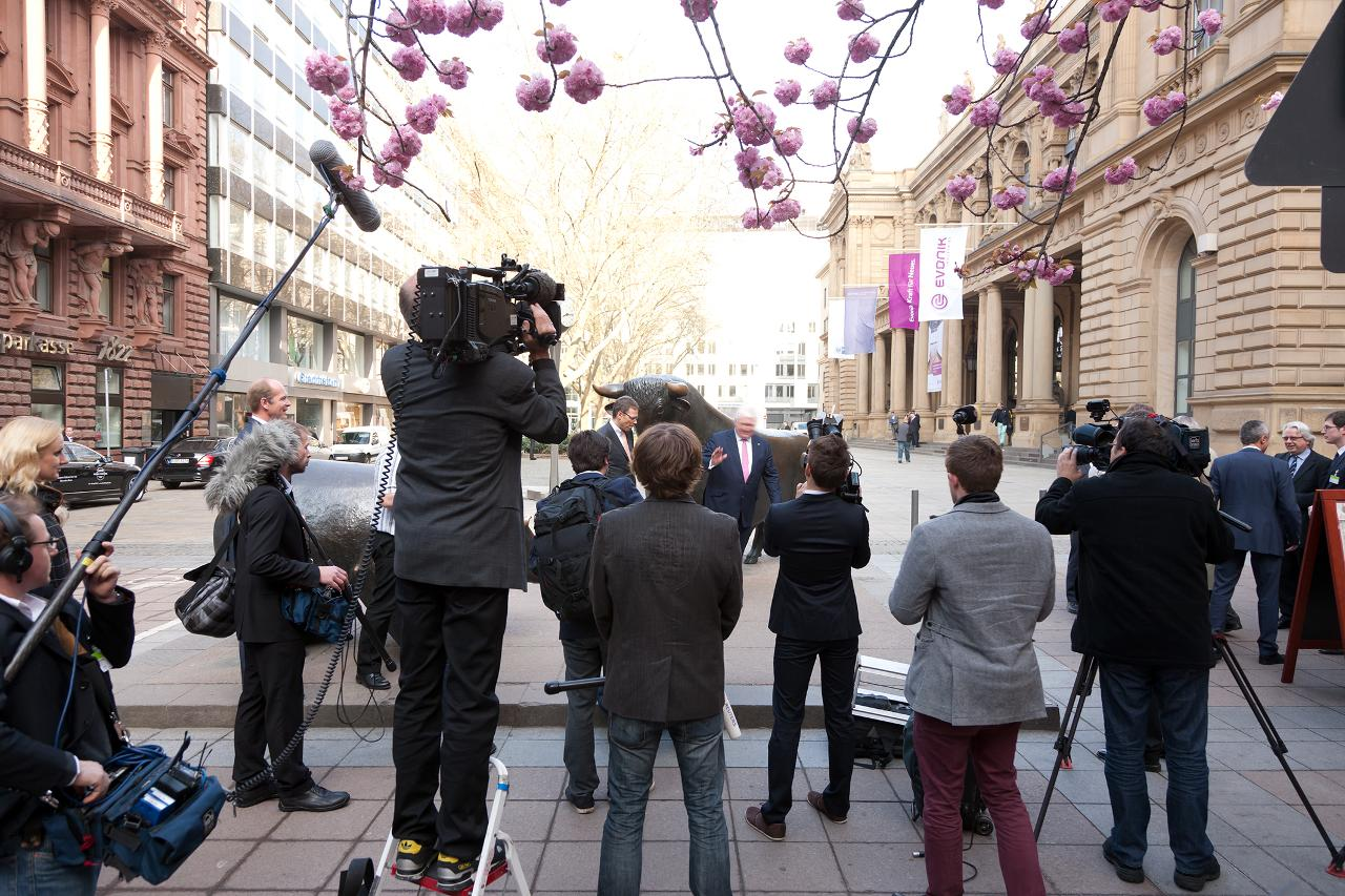 TV interview in front of the stock exchange building (landscape)